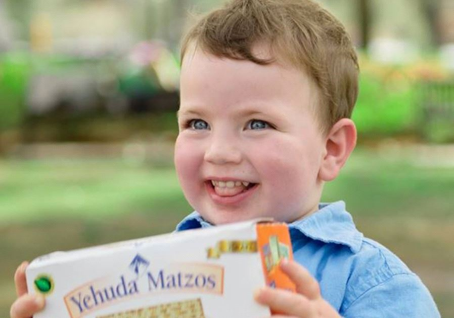 A child with a Yehuda Box