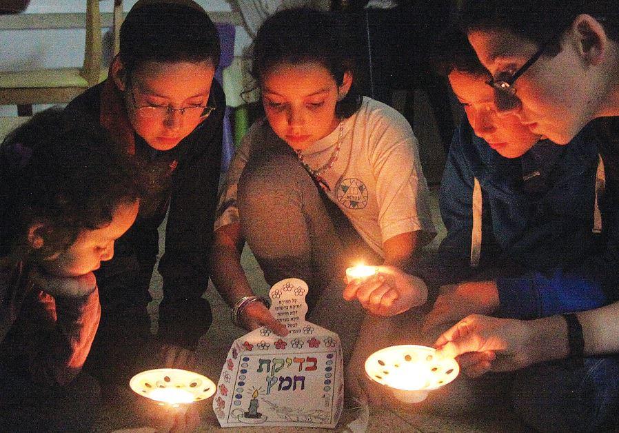 MEMBERS OF the Nataf family take part in 'bedikat hametz' ritual in Jerusalem.