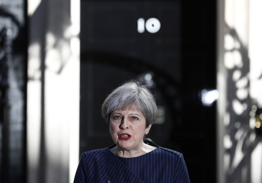 Britain's Prime Minister Theresa May speaks to the media outside 10 Downing Street, in central Londo