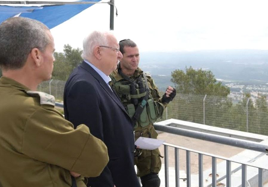 RIVLIN RECEIVES a briefing at the Lebanese border.