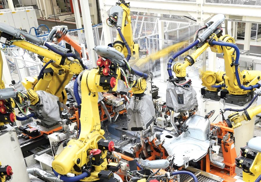 WELDING ROBOTS surround the body of a VW Golf car in a production line at the plant of German carmak