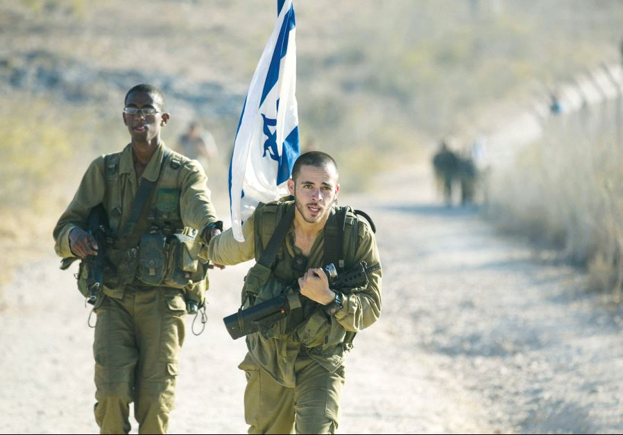 d9fba70c282bb A soldier from the Golani Brigade holds a comrade s hand as he helps him  during a 70-kilometre march