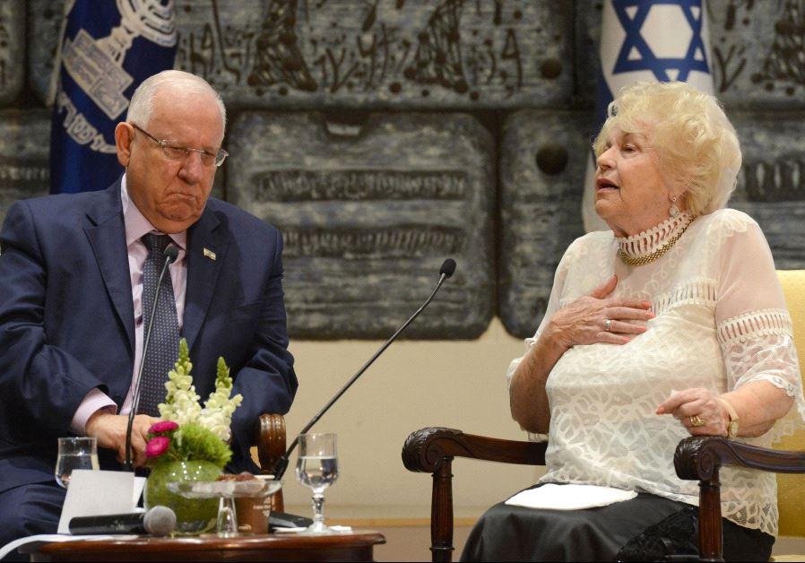 President Reuven Rivlin speaks to Holocaust survivor Miriam Eshel.