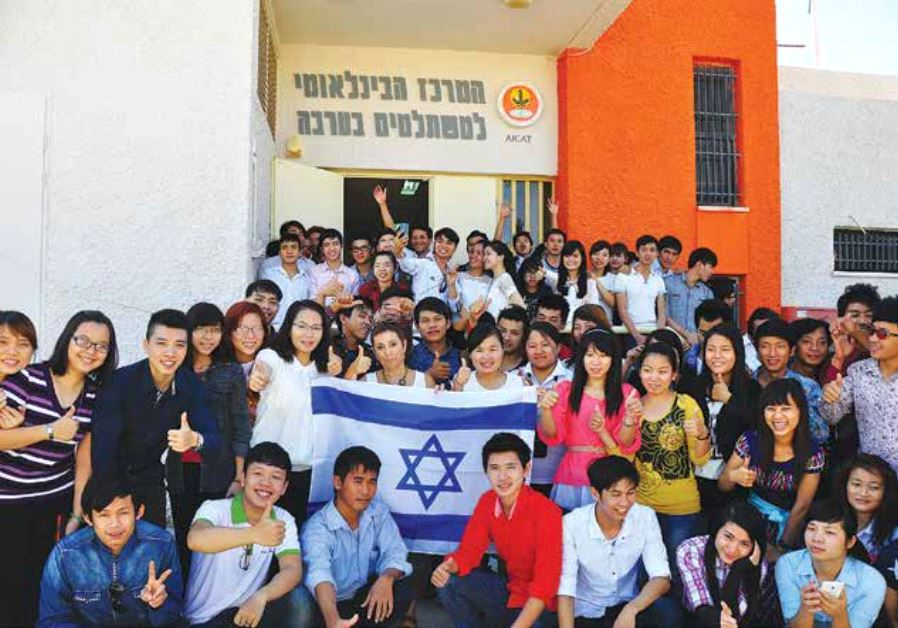 AICAT students show their support for Israel in the Arava with AICAT director Hanni Arnon.