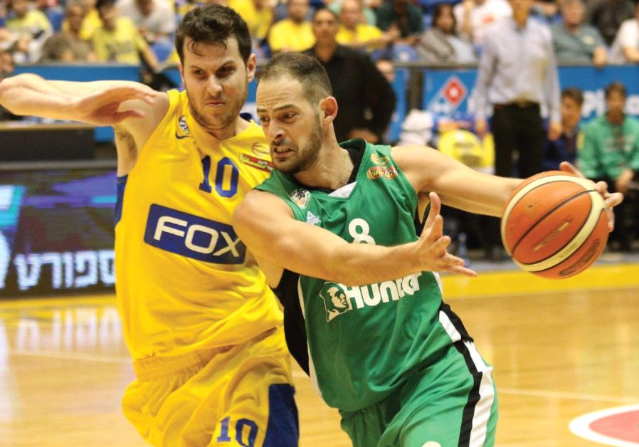 Maccabi Haifa forward Amit Simhon (center) scored 16 points in last night's 79-63 win over Maccabi T