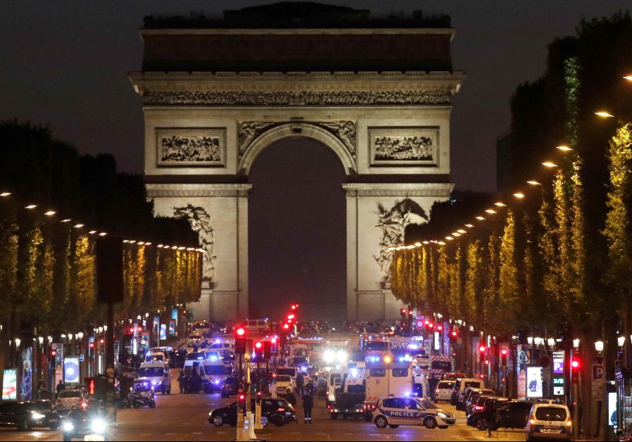 Police secure the Champs Elysees Avenue after a shooting incident in Paris, France