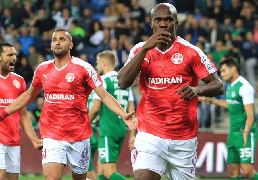 Hapoel Beersheba forward Anthony Nwakaeme (right) celebrates after scoring his team's winner in last