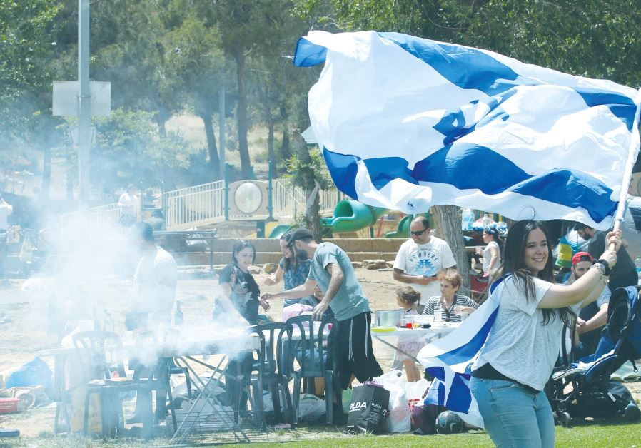 PEOPLE CELEBRATE independence day with flags and barbecue in Jerusalem's Sacher Park