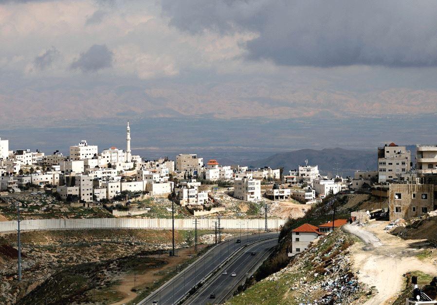 THE PALESTINIAN COMMUNITY of Shuafat sits next to a Jewish neighborhood in Jerusalem. 'To take advan