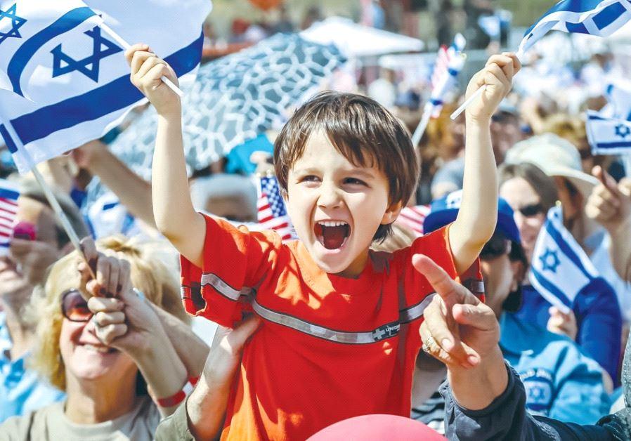 PEOPLE PARTICIPATE in a Celebrate Israel Festival event in 2016.
