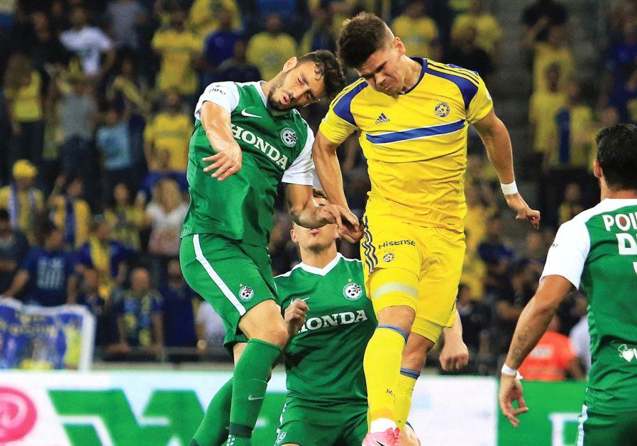 Maccabi Tel Aviv striker Vidar Orn Kjartansson (in yellow) netted his team's opener in last night's