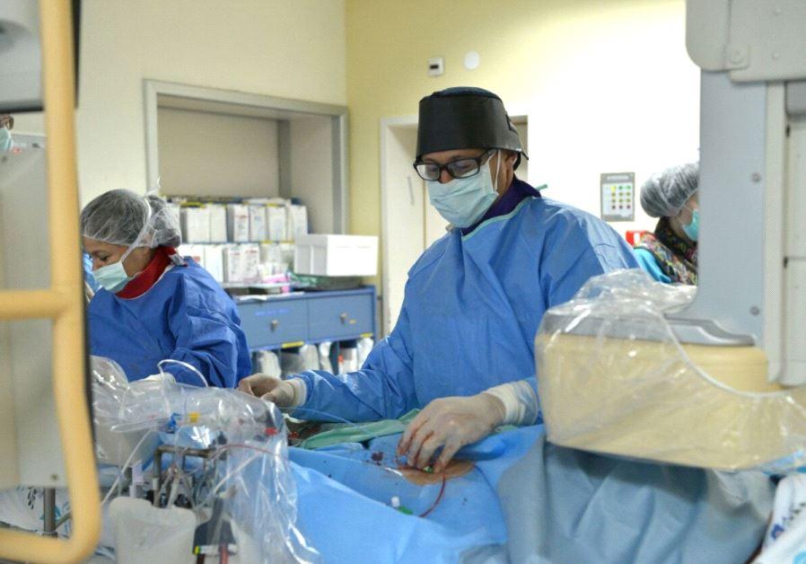 Doctor Sagi Assa operating on the heart of 11-year-old Marwan Ghazi Ali.