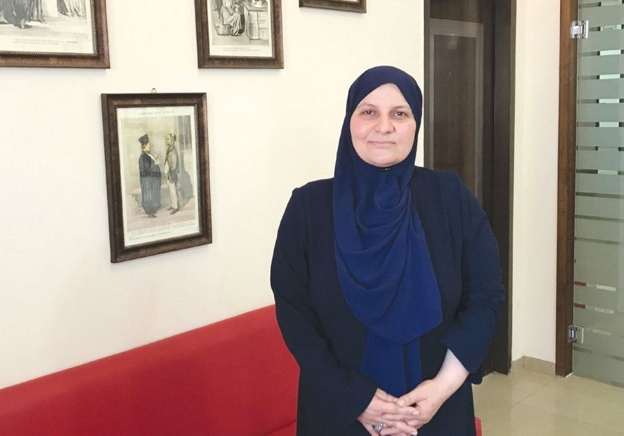 SLAMIC JURIST Hana Mansour-Khatib poses Sunday in her office in Tamra, in the eastern Galilee.
