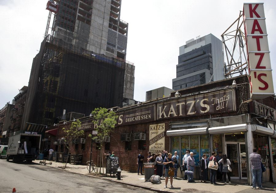 People stand in line at Katz's Delicatessen, the famous deli founded in 1888, in New York's lower Ea