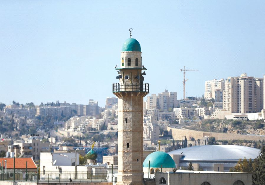 THE MINARET of a mosque is seen in the Arab neighborhood of Beit Safafa in Jerusalem