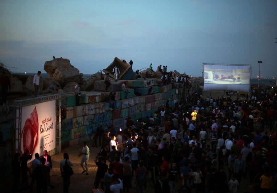 A film is screened during the third edition of the Red Carpet Film Festival, at the seaport of Gaza