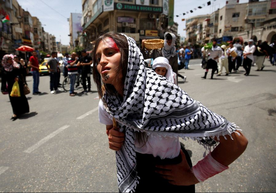 Palestinians re-enact a scene from the 1948 Nakba during a rally marking the 68th anniversary of the Nakba in the West Bank city of Ramallah May 15, 2016. (REUTERS/Mohamad Torokman)