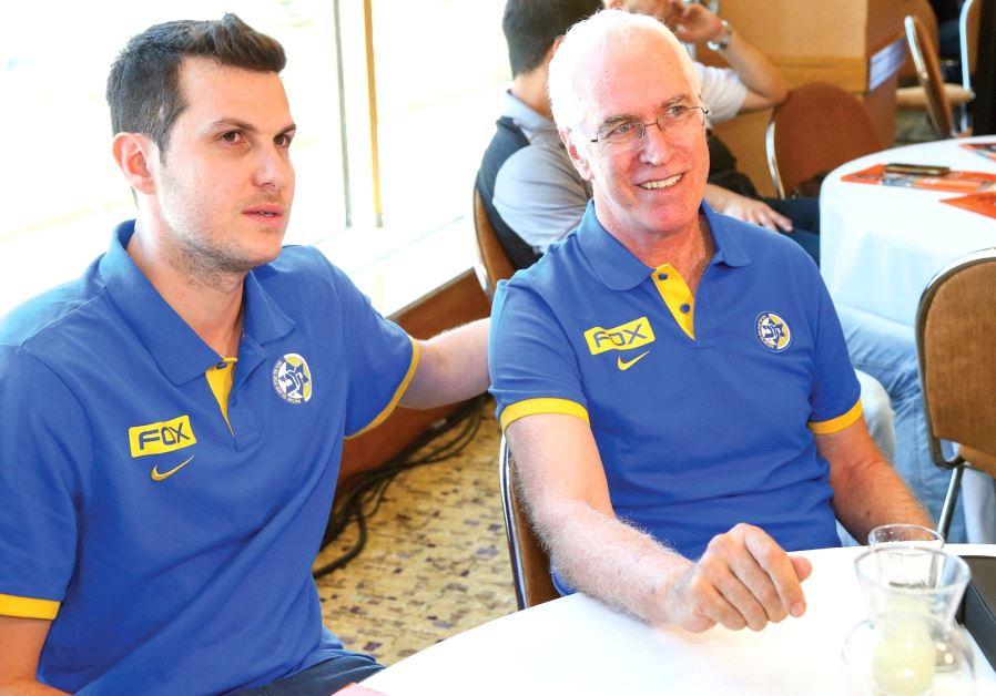 Maccabi Tel Aviv's new coach Arik Shivek (right) sits alongside captain Guy Pnini.