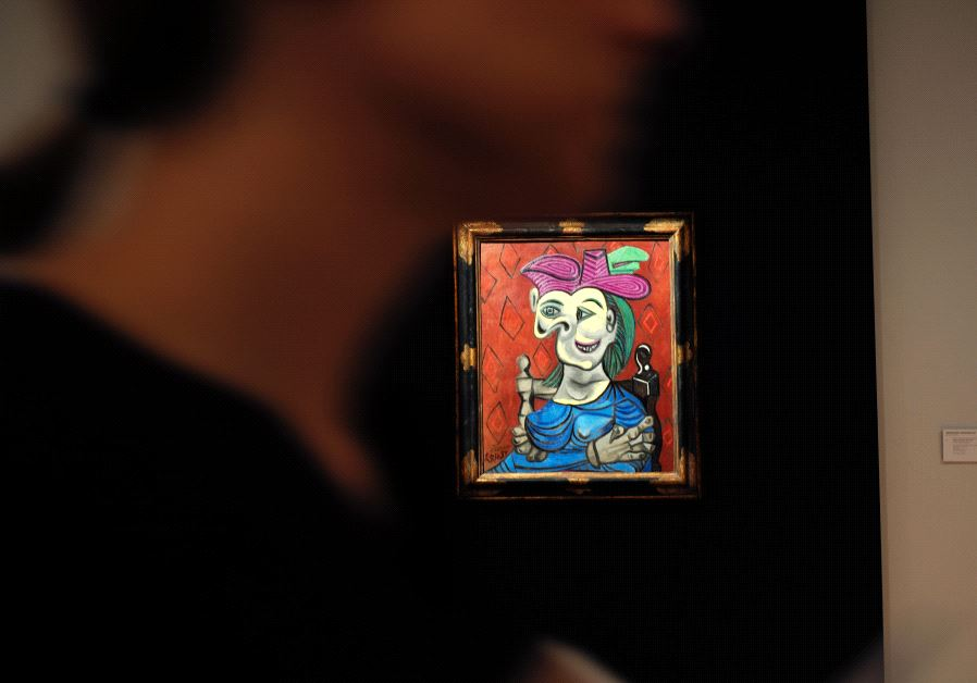"Visitors walk around Pablo Picasso's depiction of Dora Maar in ""Femme assise, robe bleu"", May 2017."