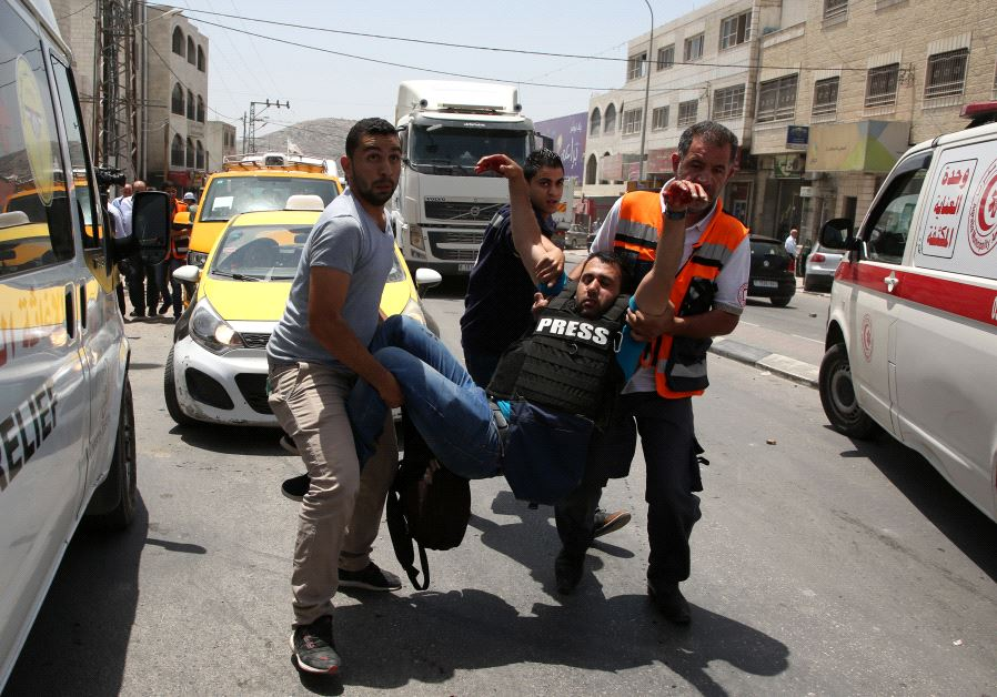 Wounded Palestinian reporter