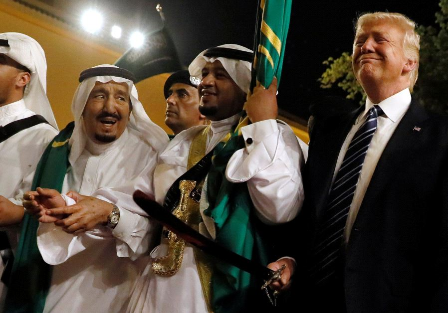 US President Donald Trump pictured dancing with swords at a reception ceremony held in his honor in