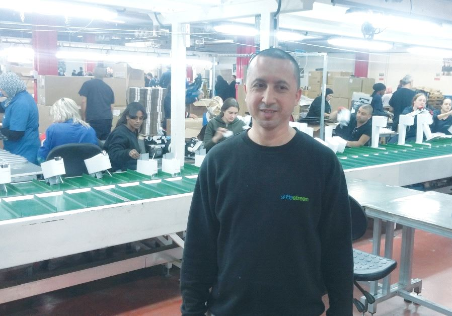 ALI JAFAR takes a break at the SodaStream factory in Rahat last year (photo credit: DAVID BRINN)