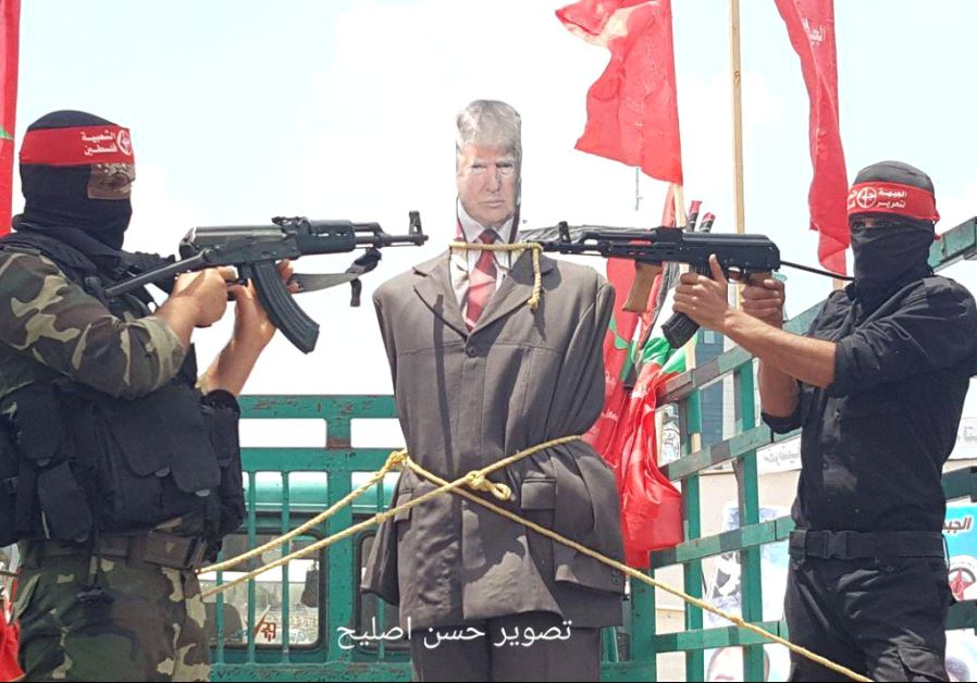 Armed men point machine guns at effigy of Donald Trump in Gaza protest, May 23 2017.