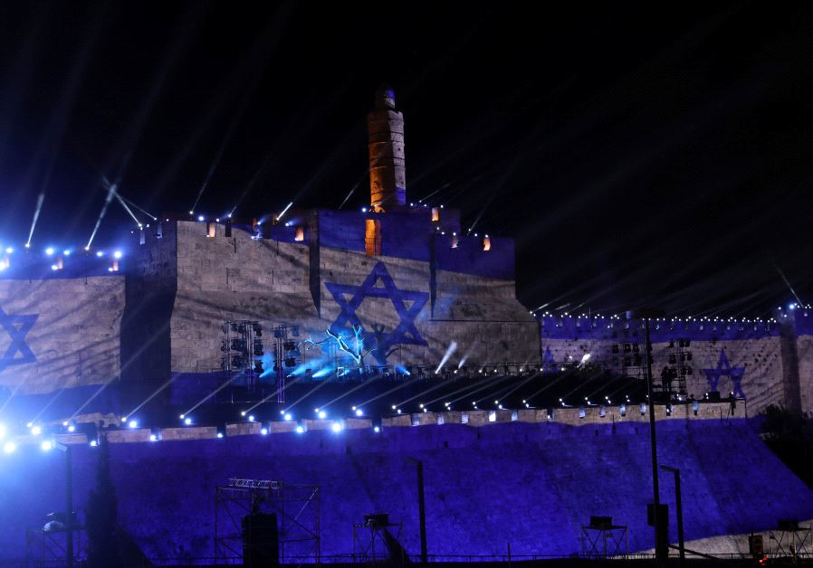 Israel's national flag is projected on the wall near the Tower of David in the Old City of Jerusalem