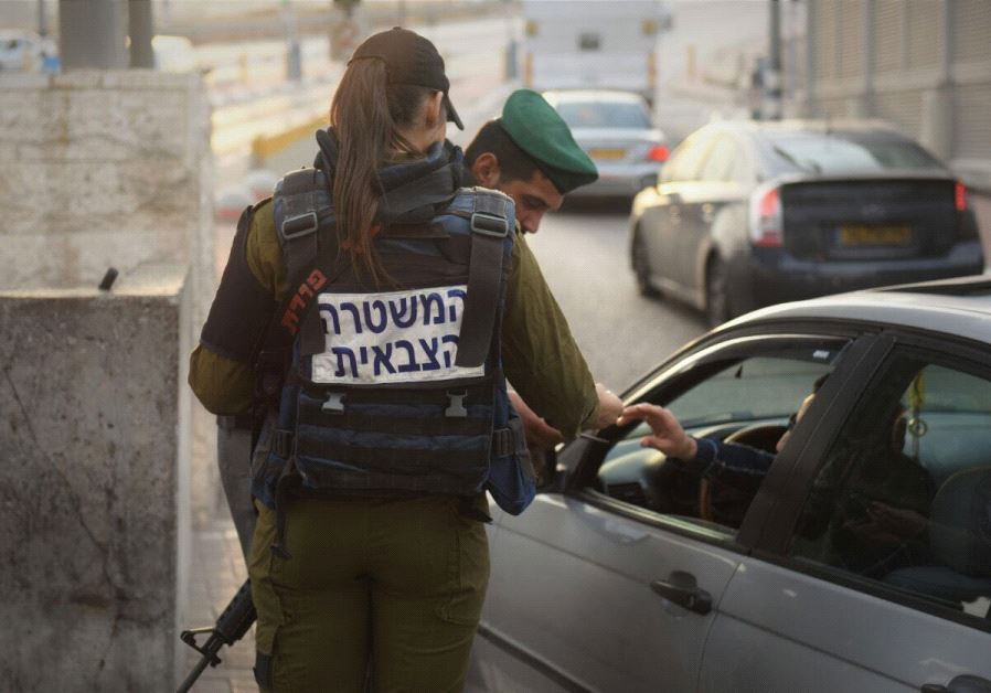 Soldiers of the IDF's Taoz Battalion at checkpoints between Israel and the West Bank
