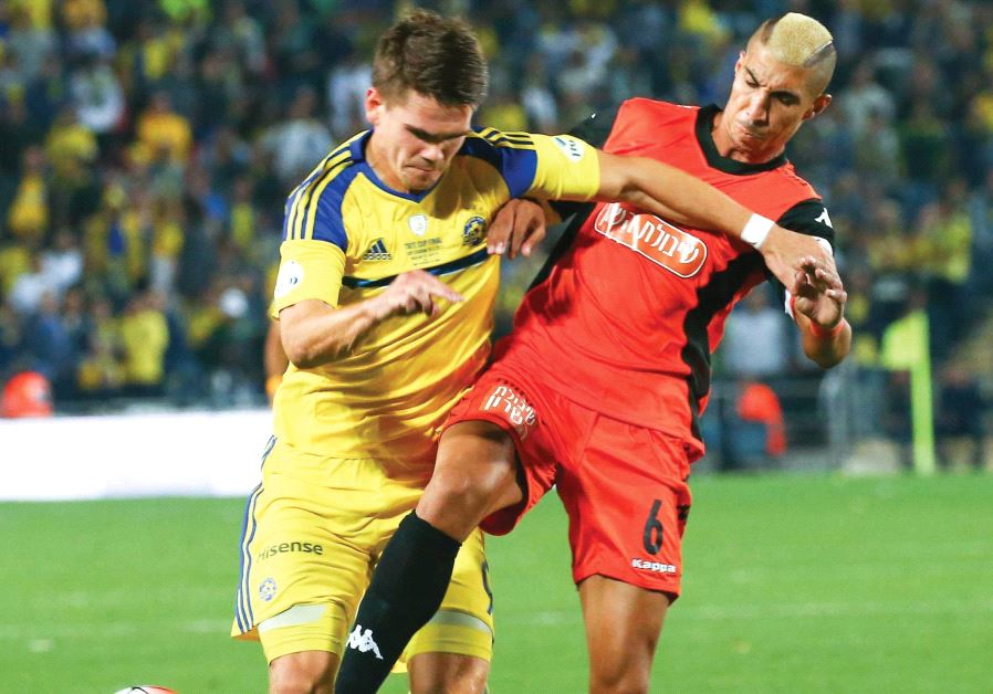 Maccabi Tel Aviv striker Vidar Orn Kjartansson (left) battles Bnei Yehuda defender Tal Kahila during