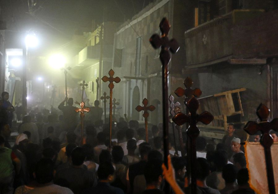 Mourners carry crosses after the funeral of Coptic Christians who were killed on May 26, 2017.