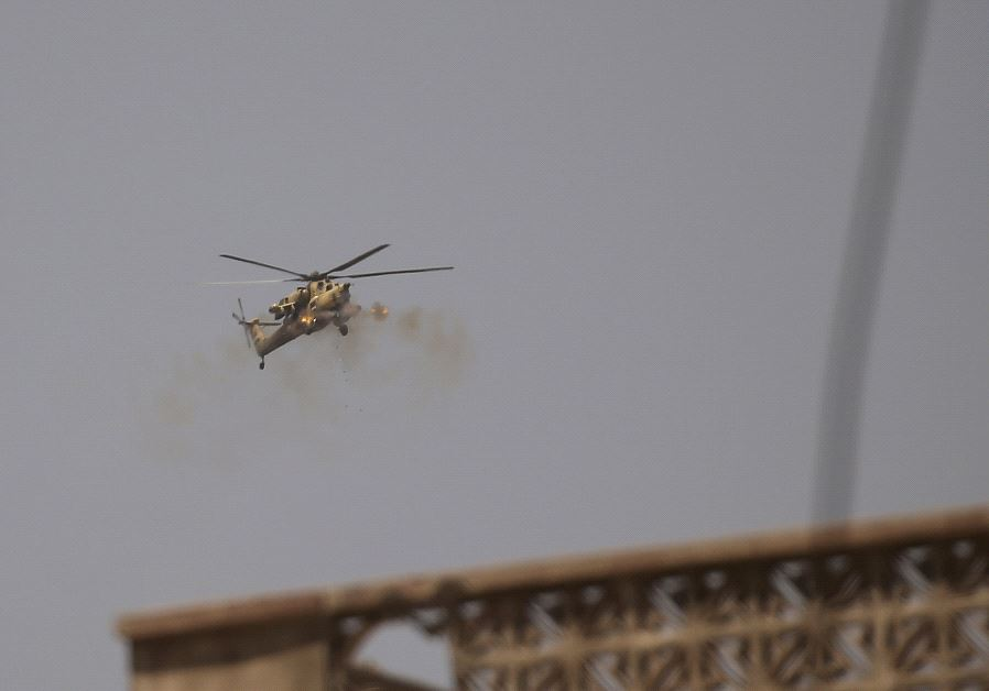 A helicopter of the Iraqi Army fires against Islamic State positions in western Mosul, Iraq May 27,