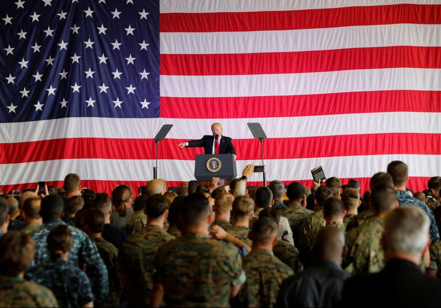 U.S. President Donald Trump delivers remarks to U.S. military personnel at Naval Air Station Sigonel