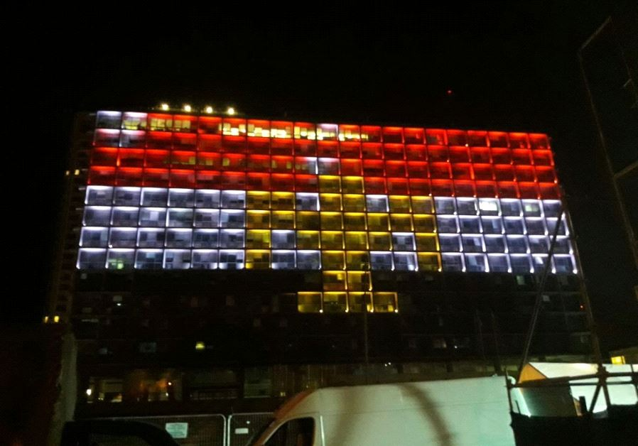 Tel Aviv City Hall lights up in solidarity with Egypt following Friday's terror attack that claimed
