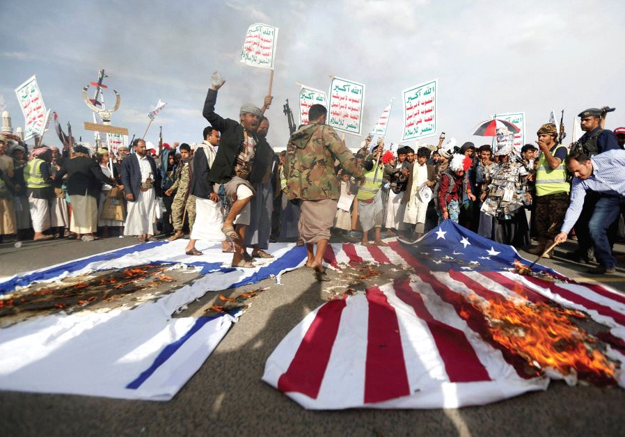 HOUTHI FOLLOWERS burn US and Israeli flags during a demonstration in Sanaa, Yemen in 2017