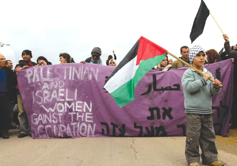 PRO-PALESTINIAN ACTIVISTS protest near the Erez Crossing in 2008.