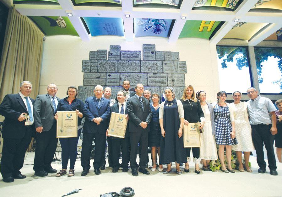 PRESIDENT REUVEN RIVLIN and Mayor Nir Barkat pose with the Jerusalem Unity Prize winners yesterday