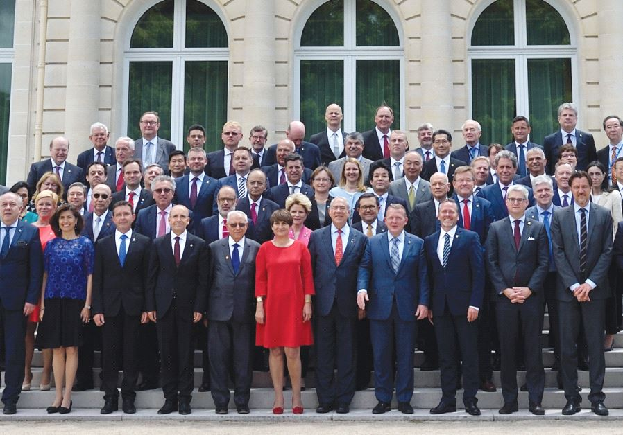 FINANCE MINISTER Moshe Kahlon and his counterparts smile at the OECD Ministerial Council meeting in