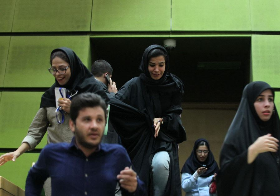 Women are seen inside the parliament during an attack in central Tehran, Iran, June 7, 2017.