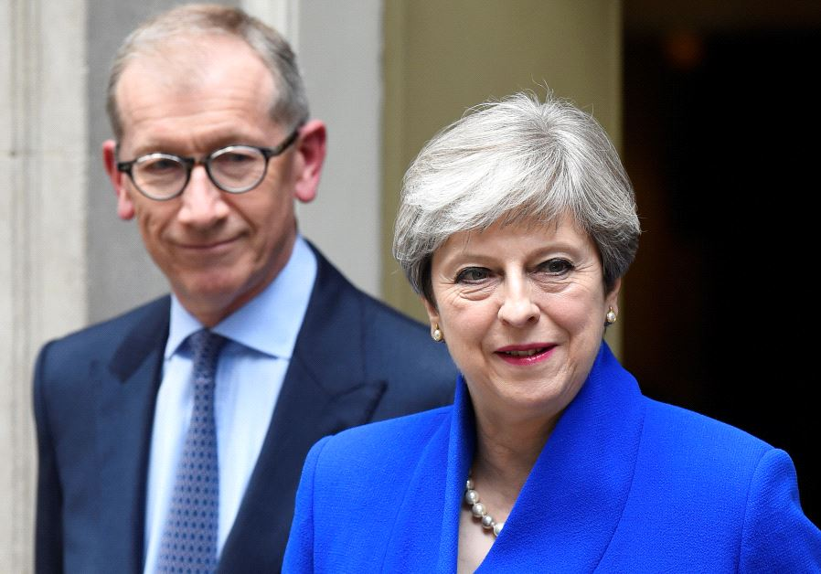 Britain's Prime Minister Theresa May leaves 10 Downing Street with her husband Philip to travel to B