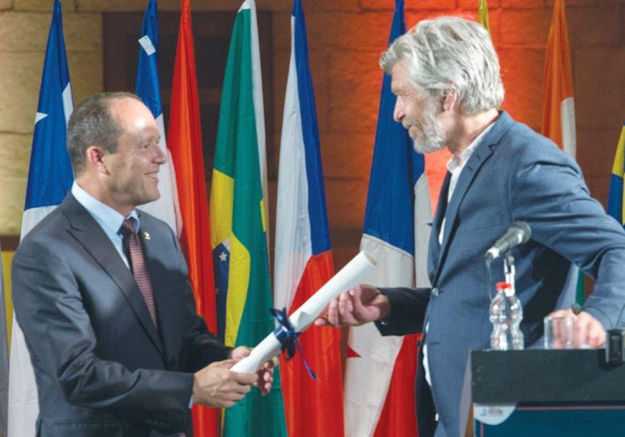 JERUSALEM MAYOR NIR BARKAT awards Norwegian author Karl Ove Knausgård the 2017 Jerusalem Prize.