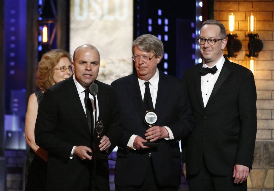 """J.T. Rogers (L) accepts Best Play for """"Oslo"""" at the 71st Tony Awards, June 11 2017."""