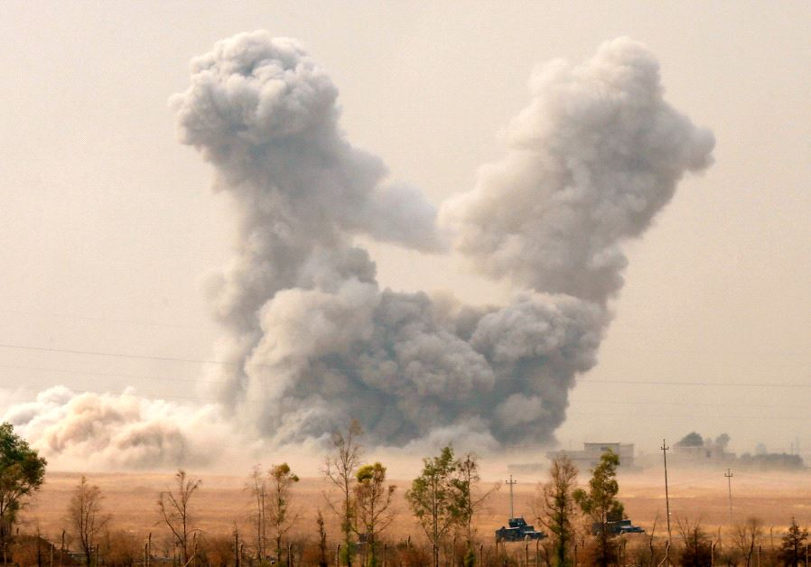 Smoke rises after an US airstrike, while the Iraqi army pushes into Topzawa village during the opera