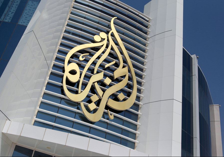 The logo of Al Jazeera Media Network is seen on its headquarters building in Doha, Qatar June 8, 201