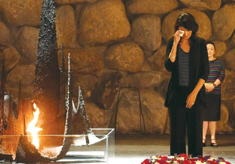 US AMBASSADOR to the UN Nikki Haley wipes a tear after laying a wreath at the Yad Vashem Hall of Rem