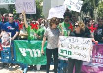 'I WANT to hear what my lecturer thinks' and 'Everything's political' read signs held by Meretz supp
