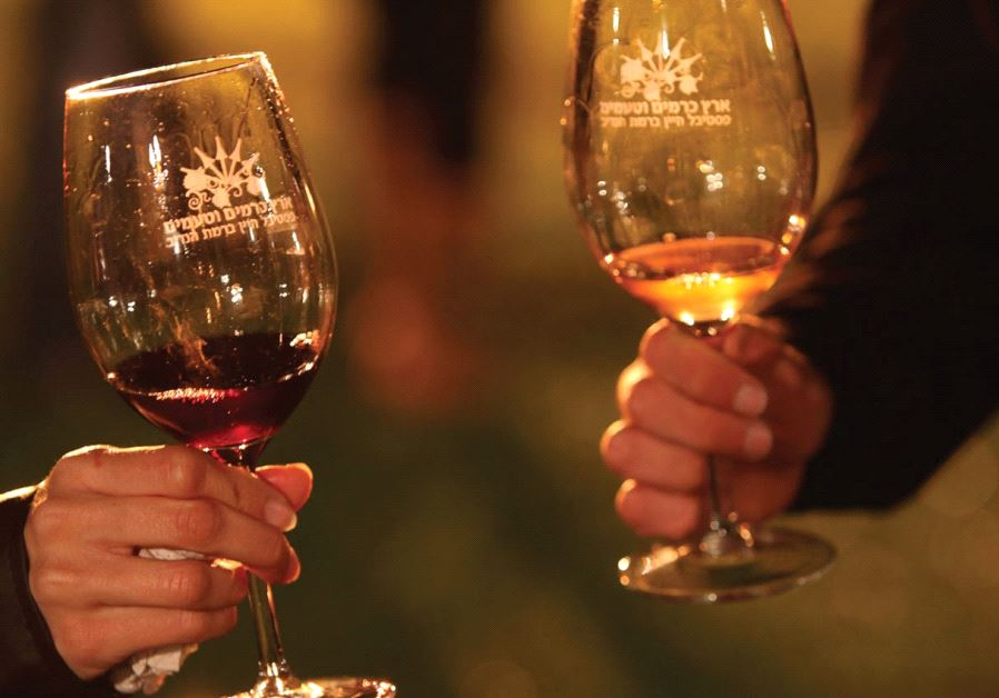 Raise your glass israel news jerusalem post israel wine people hold wine glasses ccuart Gallery
