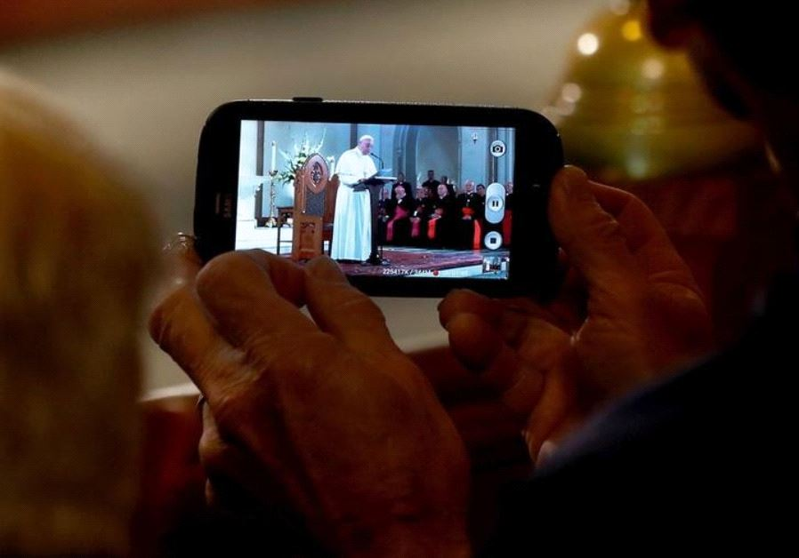 A member of the audience records Pope Francis as he speaks at St. Patrick's Catholic Church in Washington, September 24, 2015 (photo credit: REUTERS)