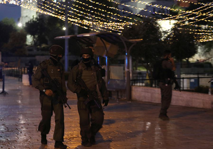 Israeli policemen secure the scene of the shooting and stabbing attack outside Damascus gate