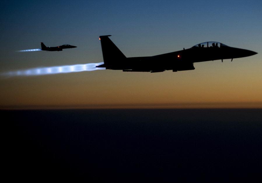 A pair of US Air Force F-15E Strike Eagles fl